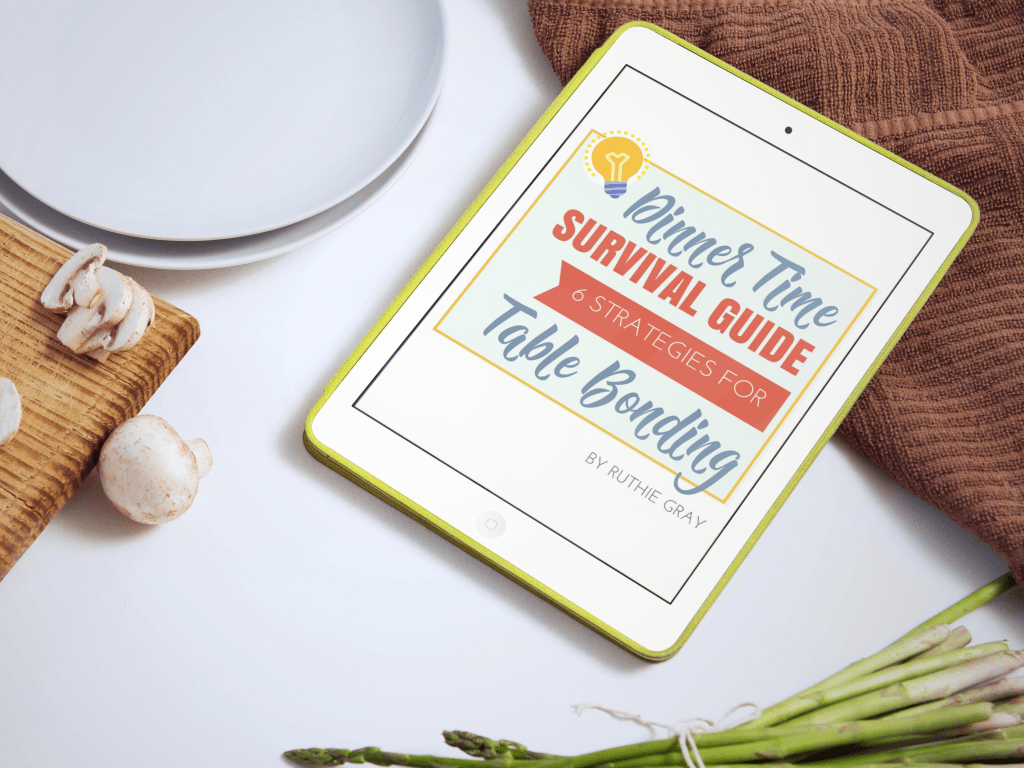 Tired of stressful family dinners with kids? I hear you, mom. Here's how to actually enjoy dinnertime with your kids, with ideas for simple meals and family bonding. Including the Dinnertime Survival Guide with 6 strategies for family table bonding. These tips work! #dinnertime #mealtime #mealtimewithkids #familydinner